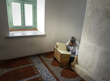 Muslims read the Qur'an in the mosque alone Royalty Free Stock Images