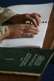 Muslims reading braille koran Quran Royalty Free Stock Photography