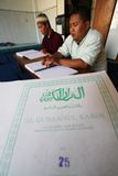 Muslims reading braille koran Quran Stock Image