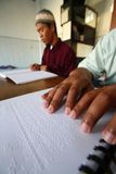 Muslims reading braille koran Quran Stock Images