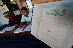 Muslims reading braille koran Quran Stock Images