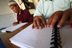 Muslims reading braille koran Quran Royalty Free Stock Photo