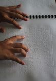 Muslims reading braille koran Quran Stock Photos