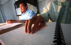 Muslims reading braille koran Quran