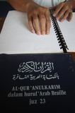 Muslims reading braille koran Quran Stock Photo