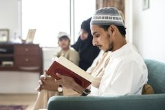 Muslims reading from the Quran at home royalty free stock photography