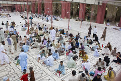 Muslims waiting for time to breaking fast. Muslims waiting for breaking fast  at a famous mosque in Karachi Pakistan known as Memon Masjid Royalty Free Stock Photography