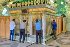 Muslims worship of  Seyed Alaedin Hossein tomb, Shiraz, Iran. Fars Province, Shiraz, Iran - 18 april, 2017:  Muslims pray in front of Sayyed Alaeddin Hossein Royalty Free Stock Image