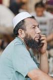 Muslimsk försäljare på en loppmarknad, Peking, Kina Royaltyfria Foton