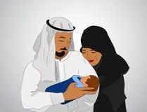 Muslimsk familj med ett barn Arkivbild