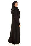 Muslimsk kvinna som tillbaka ser Royaltyfri Foto
