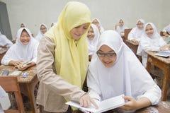 Muslimska studenter Arkivbild