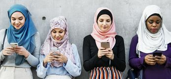 Muslin women hijab connecting communication technology togetherness stock image