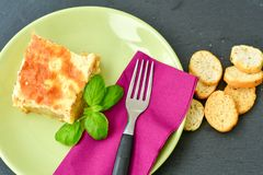 Mussaka and bred. Bulgarian moussaka with eggplant, potatoes, minced meat and bechamel sauce Royalty Free Stock Image