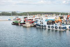 Mussel aquaculture boats anchored in the port of O Grove. Galicia, Spain royalty free stock images