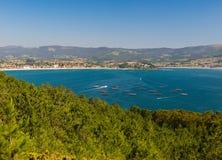 Mussel barges in Ria de Vigo near to Nigran stock images