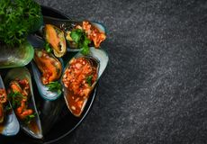 Mussel cooking pan seafood plate with Shellfish green mussels shell ocean gourmet dinner cooked stock images