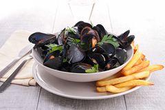 Mussel and french fries Stock Image
