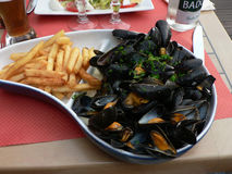 Mussel and frites. Picture of a seafood plate at a french restaurant Royalty Free Stock Images