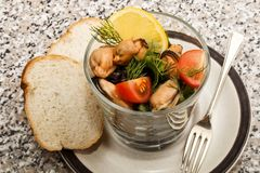 Mussel salad in a glass with bread Stock Image