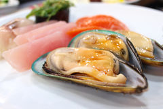 Mussel with sauce Stock Photos