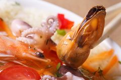 Mussel without shell close up in Asian soup Royalty Free Stock Photo