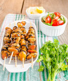 Mussel skewers with fresh salad Stock Photos