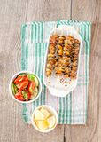 Mussel skewers with fresh salad Stock Photo