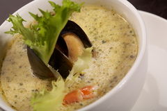 Mussel soup with saffron Stock Photography