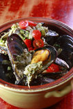 Mussel stew. On the pot Royalty Free Stock Photography