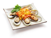 Mussel with tomato, carrot and parsley. On the squared plate over white background Stock Photo