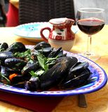Mussels in the Amalfi coast style. Portion of mussels served on the traditional Amalfi coast plate Stock Photo