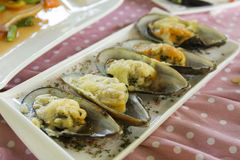 Mussels baked with parmesan cheese Stock Photo