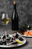 Mussels boiled in a sauce of white wine, served with toast and lemon. royalty free stock photo