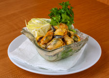 Mussels in butter sauce Royalty Free Stock Images