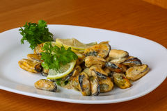 Mussels in butter sauce Stock Photos
