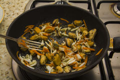 Mussels and calamary  on a pan mixed with fork Stock Photo