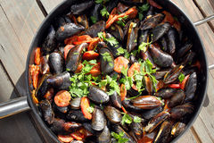 Mussels with chorizo cooking in a pan Stock Photos