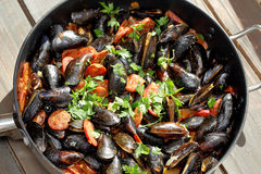 Mussels with chorizo cooking in a pan Royalty Free Stock Image