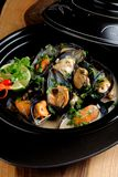 Mussels in coconut milk with lemongrass Stock Photos