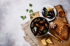 Mussels in cooking pan with parsley and wine Royalty Free Stock Photography