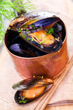 Mussels in a copper saucepan Stock Photo