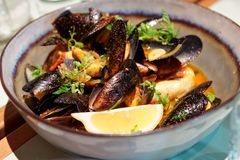Mussels in a deep clay bowl Royalty Free Stock Image