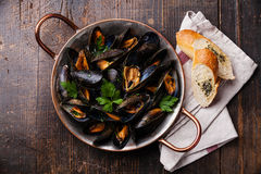 Mussels and French Baguette with herbs Stock Photo