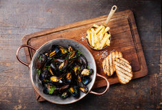 Mussels and french fries Stock Images