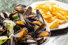 Mussels and french fries Stock Image
