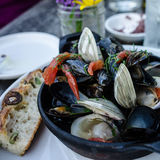 Mussels. Fresh mushrooms and olive bread Royalty Free Stock Photos