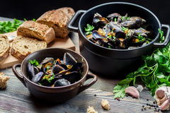 Mussels and fresh vegetables served at home stock image
