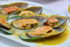 Mussels with garlic dip Royalty Free Stock Photography