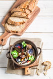 Mussels with garlic and red peppers served with bread Stock Image